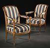 Pair of exceptional Louis XVI period carved and parcel-gilt fauteuils