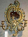 Pair of French, Louis XV style, giltwood and composition, three-arm mirror/sconces