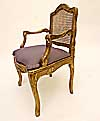 Pair of French, Regence style, carved giltwood and caned fauteuils