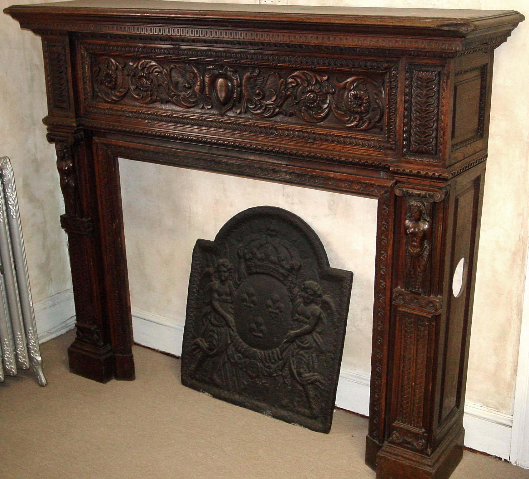 French, hand-carved wood fireplace mantel