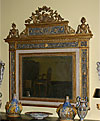 Very fine, Northern Italian, Neoclassical, painted and parcel-gilt overmantel mirror