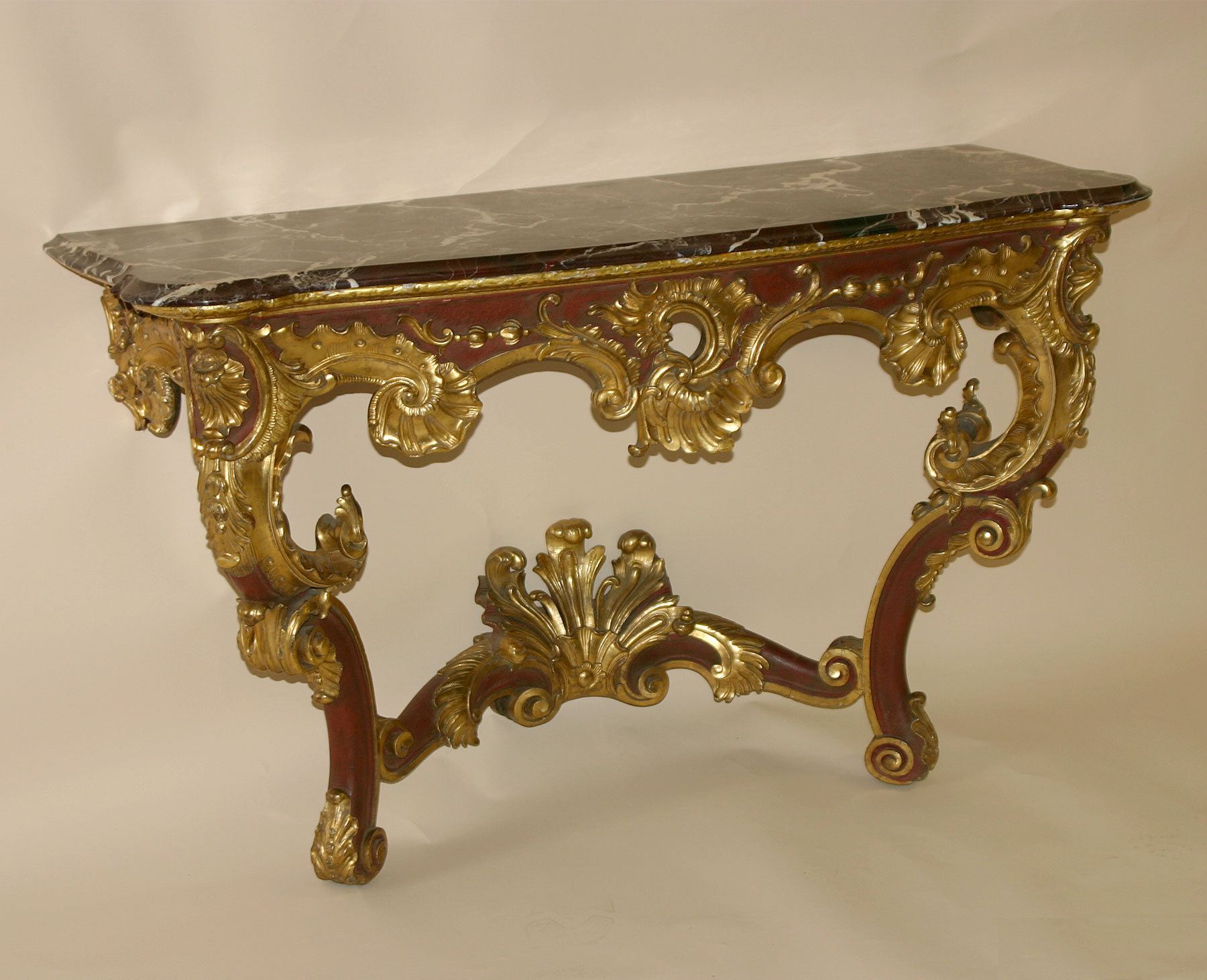 Pair of continental louis xv style red painted and parcel gilded fine pair of continental louis xv style red painted and parcel gilded console tables geotapseo Images