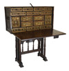 Spanish, iron-mounted, polychrome, parcel-gilt and bone-inlaid Vargue�o (travelling trunk on stand)