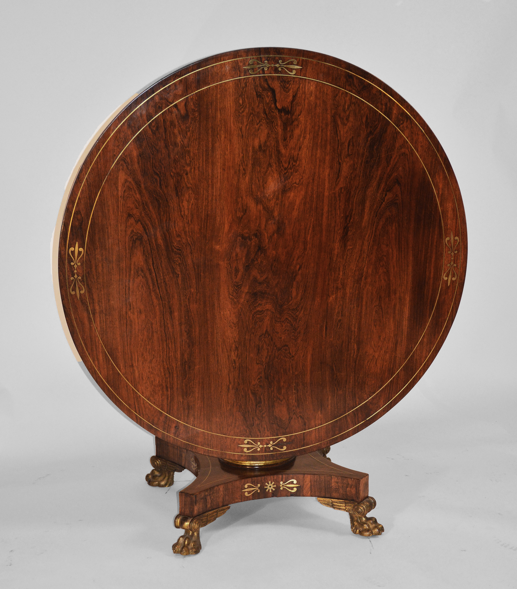 Very fine, English Regency period, rosewood and brass-inlaid center table