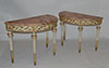 Pair of Italian, Neoclassical, white-painted and parcel-gilt demi-lune console tables