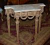 Fine, Italian, Neoclassical period, painted and parcel-gilded, diminutive console table