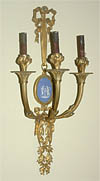 Pair of Napoleon III period (Neoclassical style), gilt bronze and porcelain three arm sconces