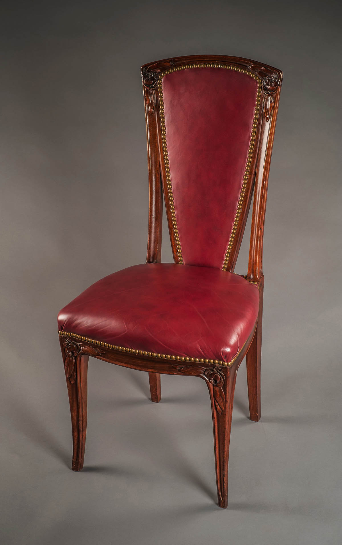 of Eight French Art Nouveau period tall back dining chairs